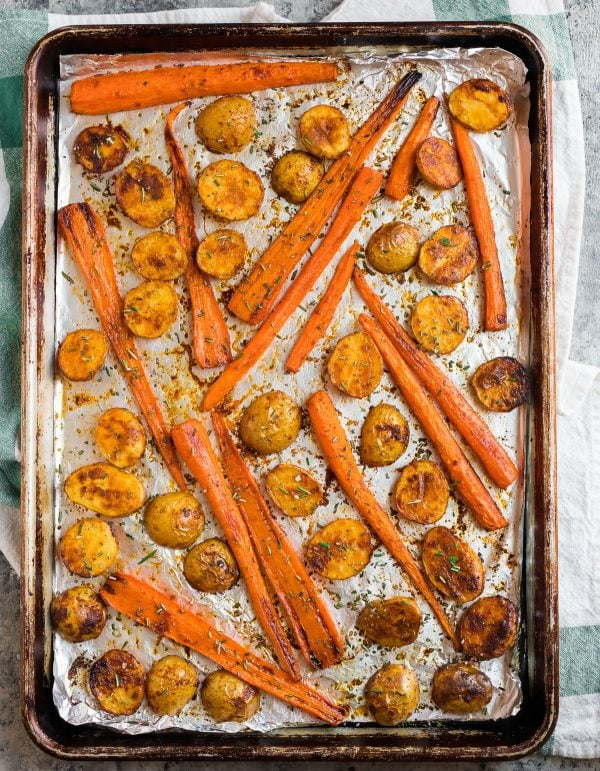 A sheet pan of caramelized Roasted Potatoes and Carrots