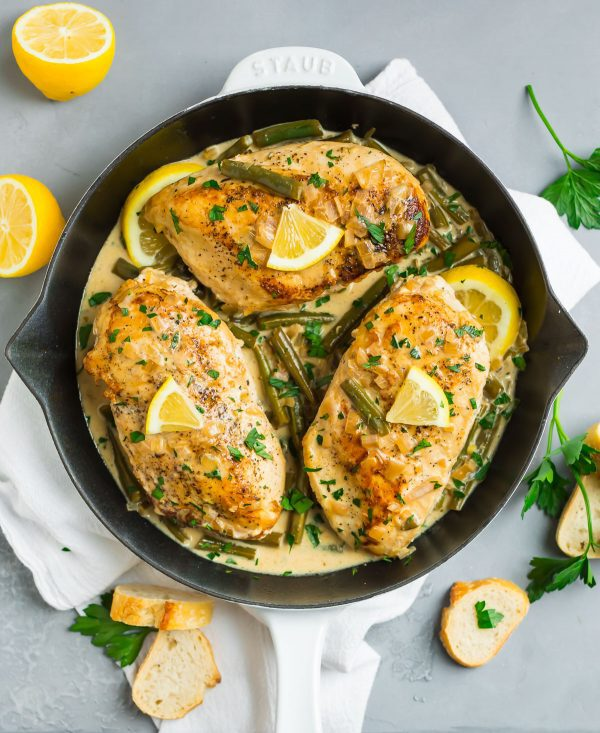 Lemon Butter Chicken in a white skillet