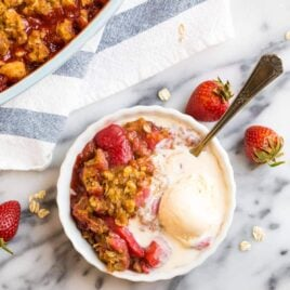 Easy Strawberry Crisp with healthy Oat topping and vanilla ice cream.