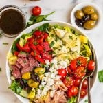 Antipasto salad in a white bowl