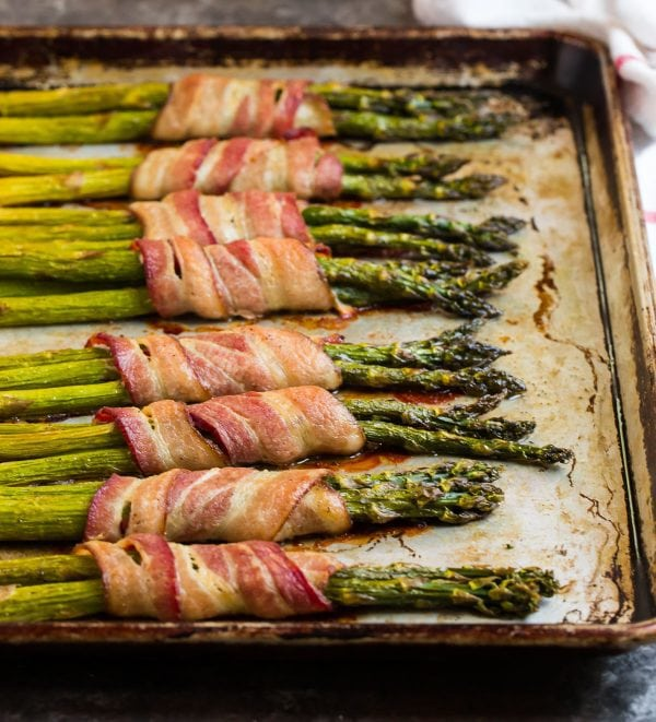 Bacon Wrapped Asparagus on a baking sheet