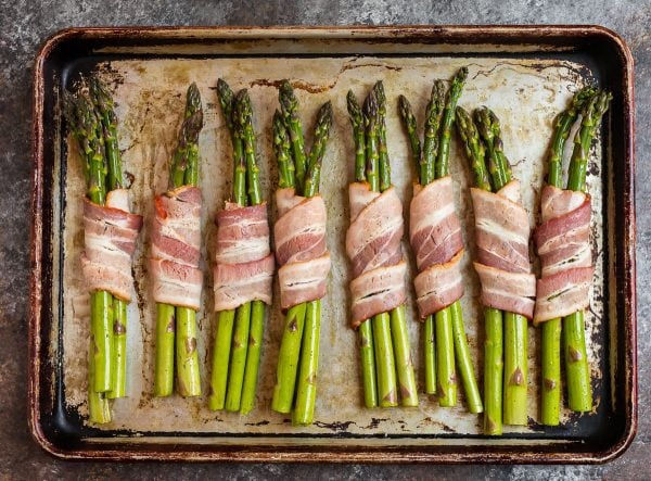 Bacon Wrapped Asparagus on a baking sheet before baking