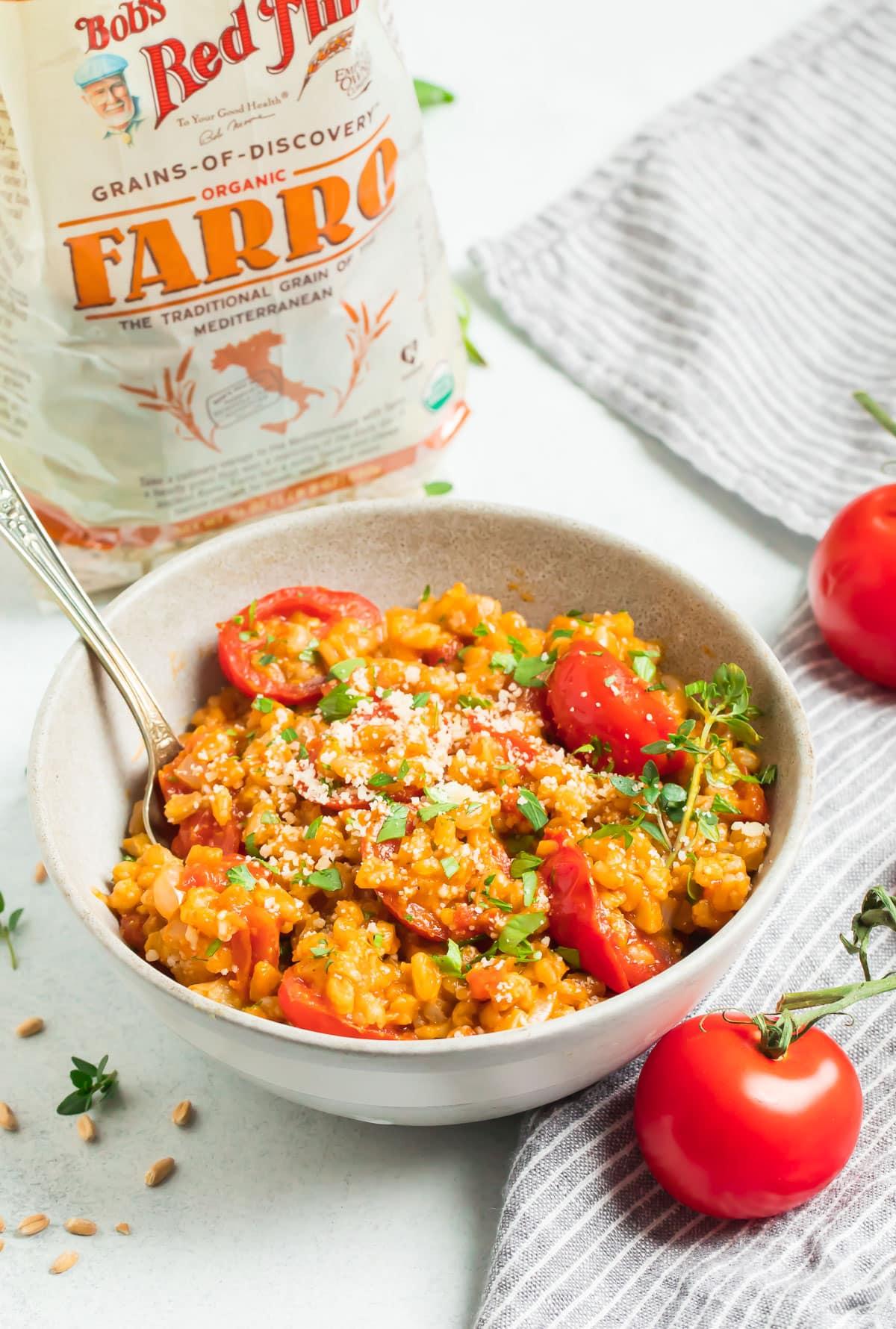 Burst Tomato Farro Risotto in a bowl with a spoon