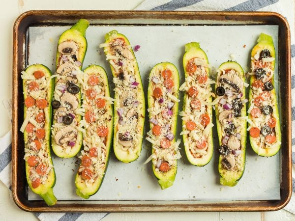 Healthy Zucchini Pizza Boats topped with many different kinds of toppings