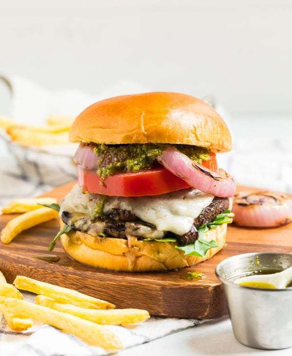 Stuffed Portobello Mushroom Burger with Cheese and Pesto in a Brioche Bun
