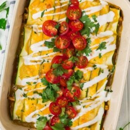 Easy Low Carb Zucchini Enchiladas with Green Sauce in a Casserole Dish