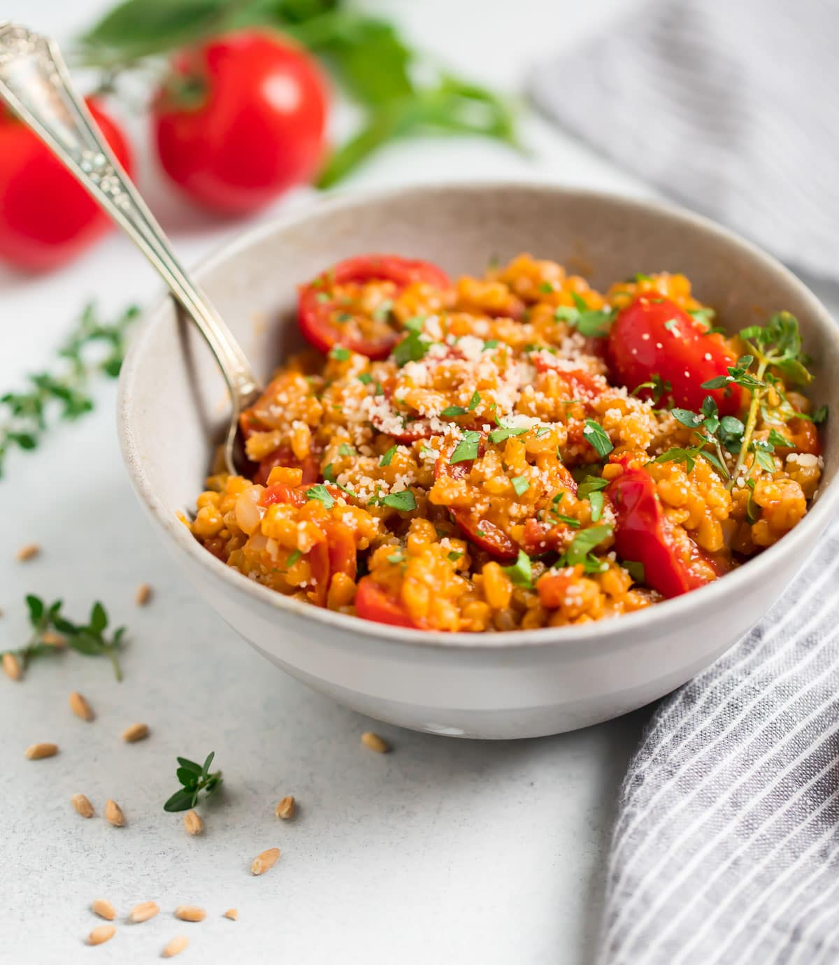 Farro Risotto with burst grape tomatoes and herbs.