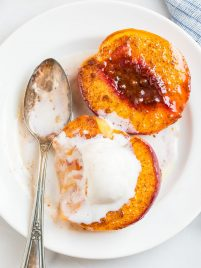 Baked Peaches in Maple Syrup with Brandy, Cinnamon, and Vanilla Ice Cream