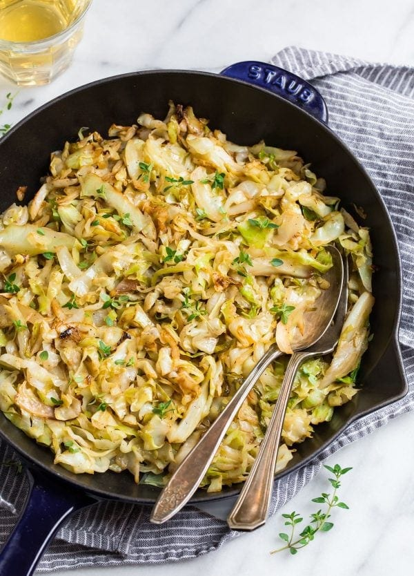 Sauteed Cabbage served in a skillet that's good for you and can be served with onion and carrots