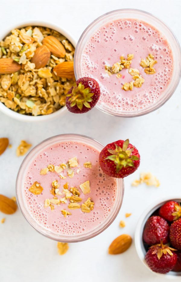 Healthy Strawberry Smoothie in a glass made with almond milk and frozen strawberry