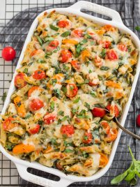 Chicken pesto pasta bake in a white baking dish
