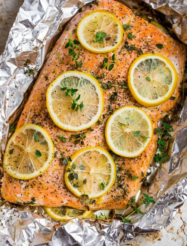 Delicious and perfectly cooked lemon pepper salmon in aluminum foil with skin