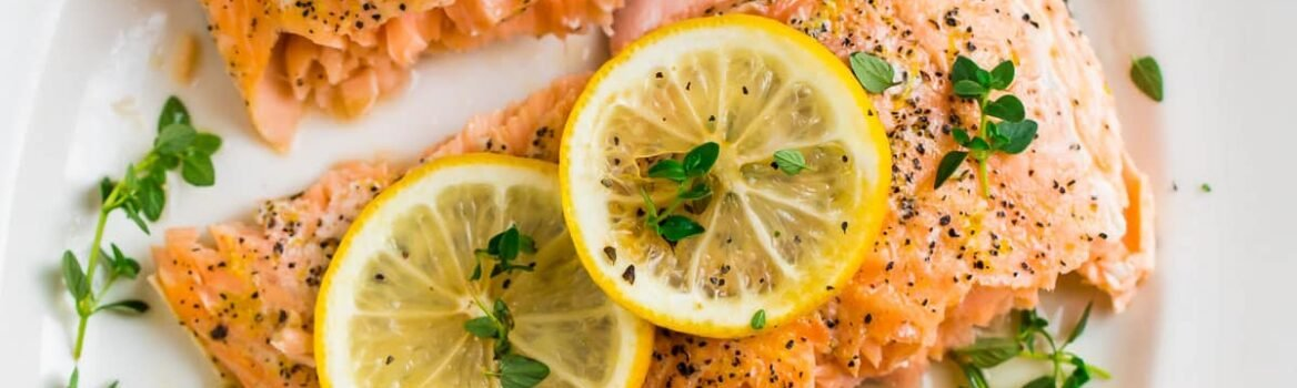Perfectly cooked Lemon Pepper Salmon baked in the oven