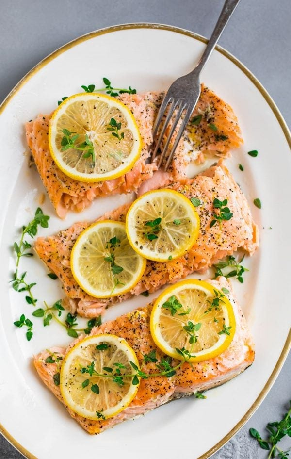 Perfectly cooked Lemon Pepper Salmon baked in foil in the oven with herbs