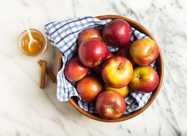 Healthy fresh apples with peels used for making naturally sweetened Crockpot Applesauce in a slow cooker
