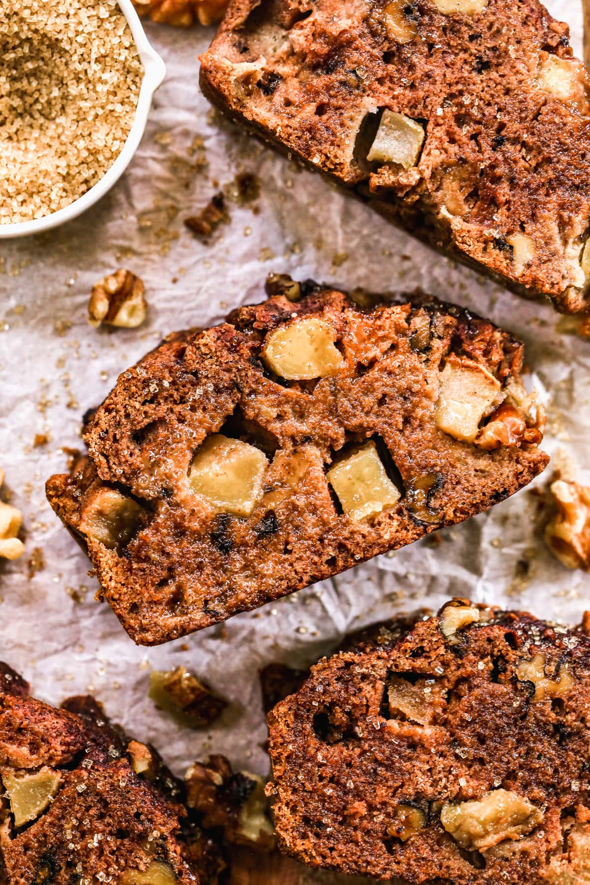 a moist slice of healthy apple bread with walnuts and fresh apple chunks
