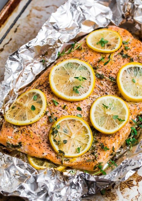 Healthy lemon pepper salmon baked in aluminum foil with skin