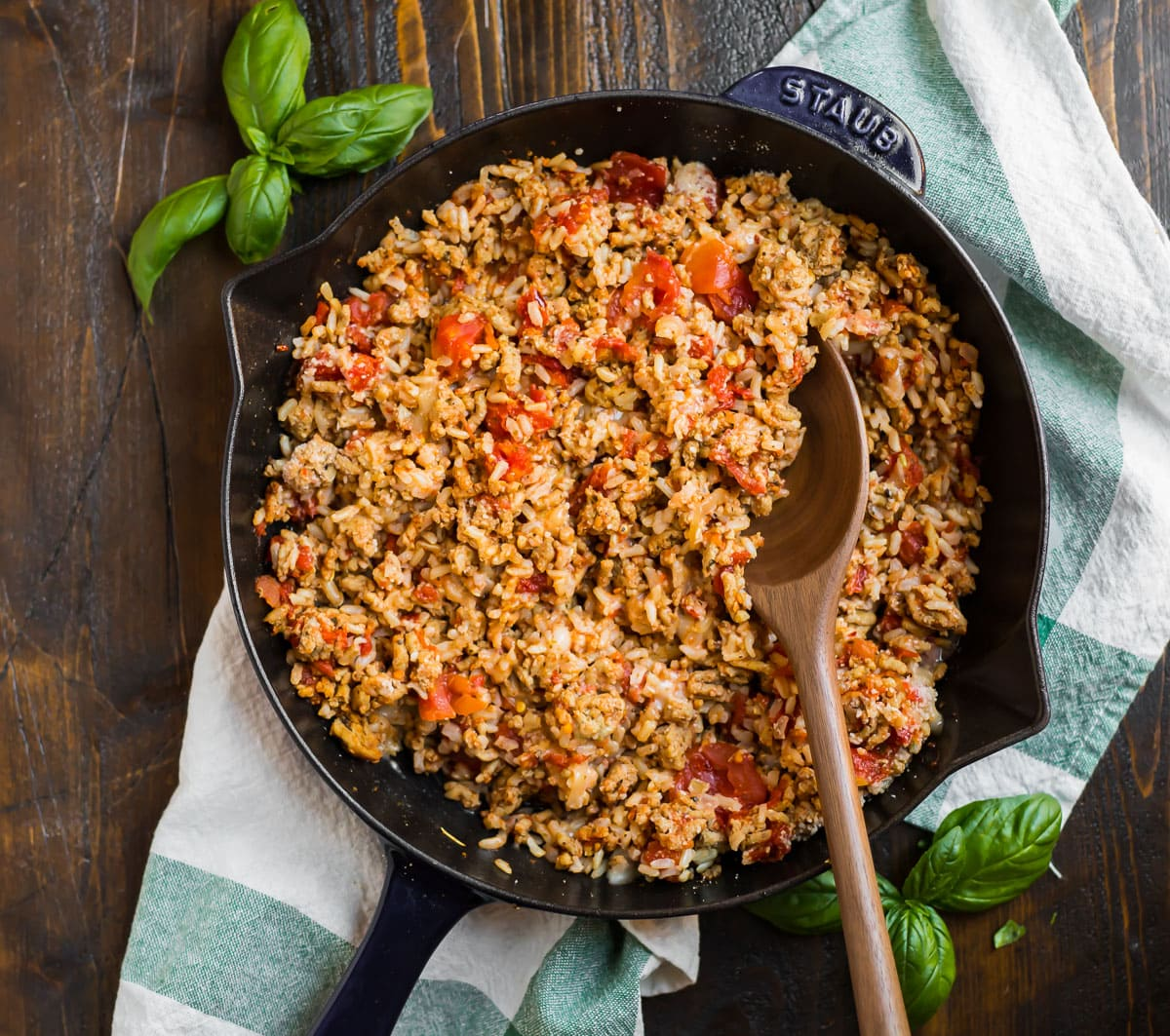 Healthy filling for stuffing peppers in a skillet with chicken and tomatoes