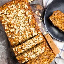 A loaf of oatmeal banana bread with oats on top