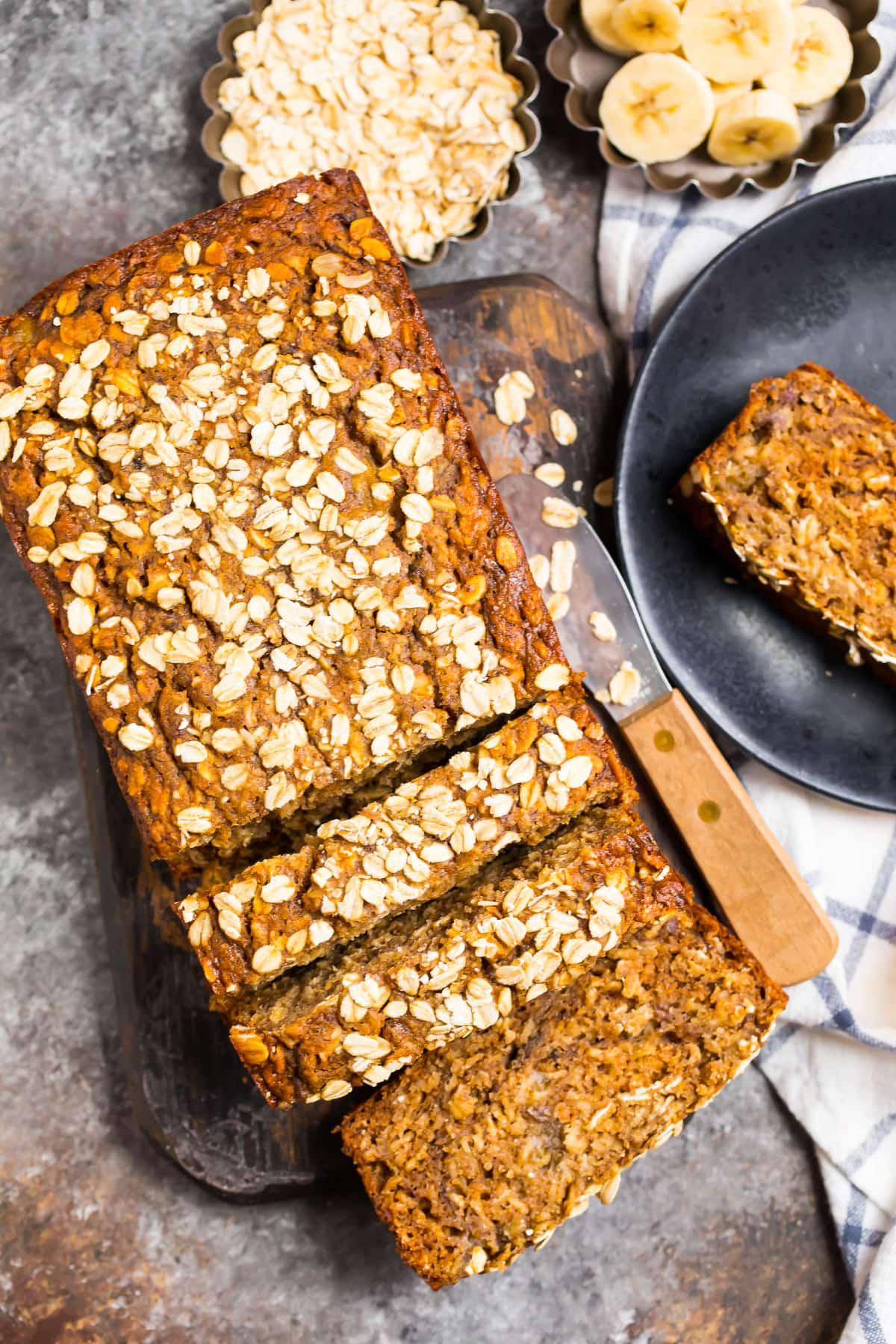 A loaf of healthy oatmeal banana bread cut into slices