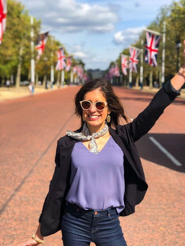 A girl standing in the road in London