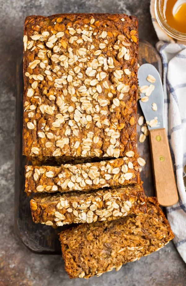 A loaf of oatmeal banana bread topped with oats