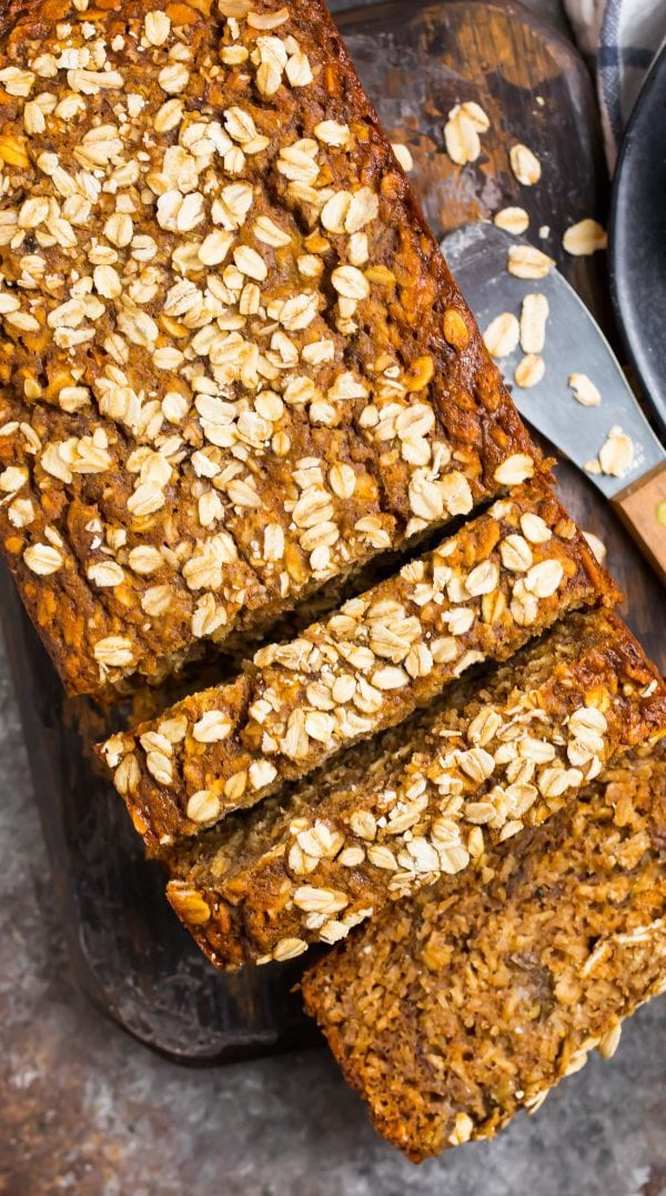 Delicious and healthy oatmeal banana bread cut into slices and topped with oats