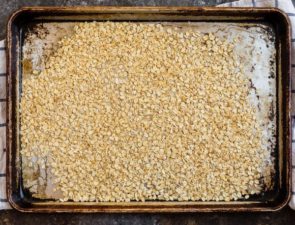 Toasted oats on a baking sheet