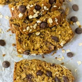 The most moist and flavorful Pumpkin Chocoalte Chip Bread. This healthy pumkin bread is whole wheat and made with coconut oil, but tastes phenomenal!