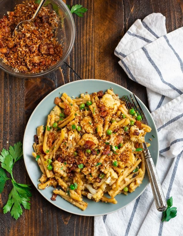 Healthy cauliflower pasta served on a plate with bacon breadcrumbs