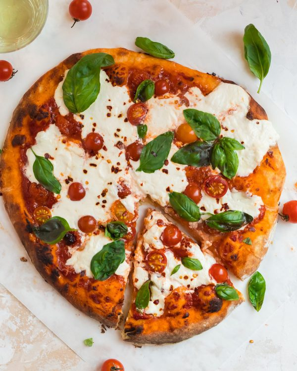 Whole Burrata Pizza Topped With Pizza Sauce, Burrata Cheese, Fresh Basil, and Cherry Tomatoes