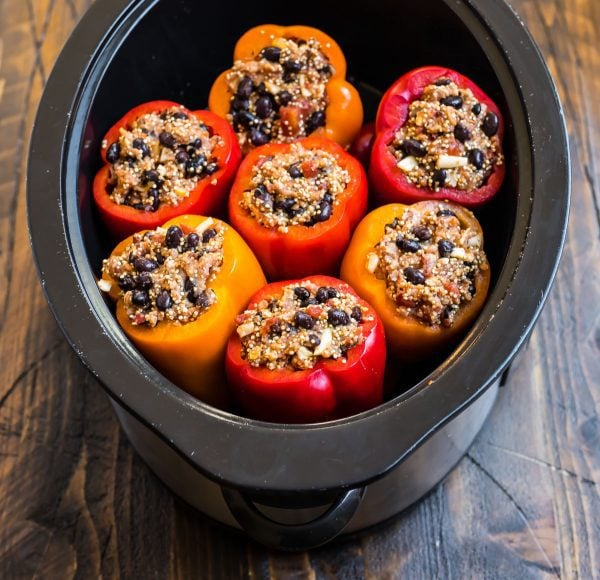 Healthy crockpot stuffed peppers in a slow cooker with quinoa and black beans