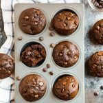 Moist and fudgy healthy chocolate muffins with chocolate chips in a muffin tin