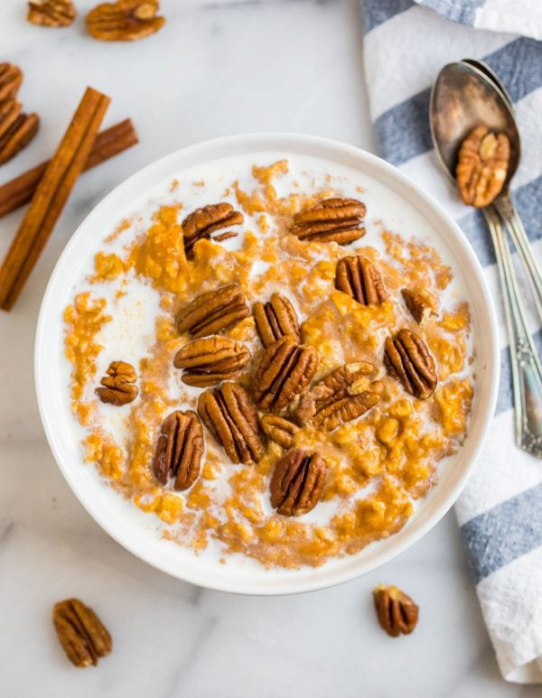 Healthy pumpkin oatmeal served in a bowl with pecans