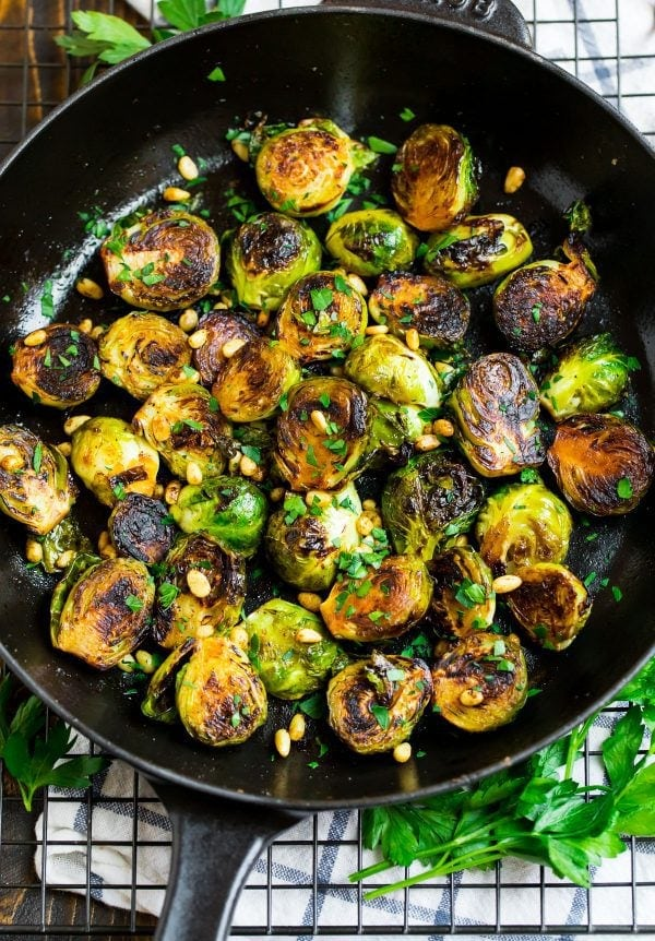 A pan of sautéed brussels sprouts with balsamic