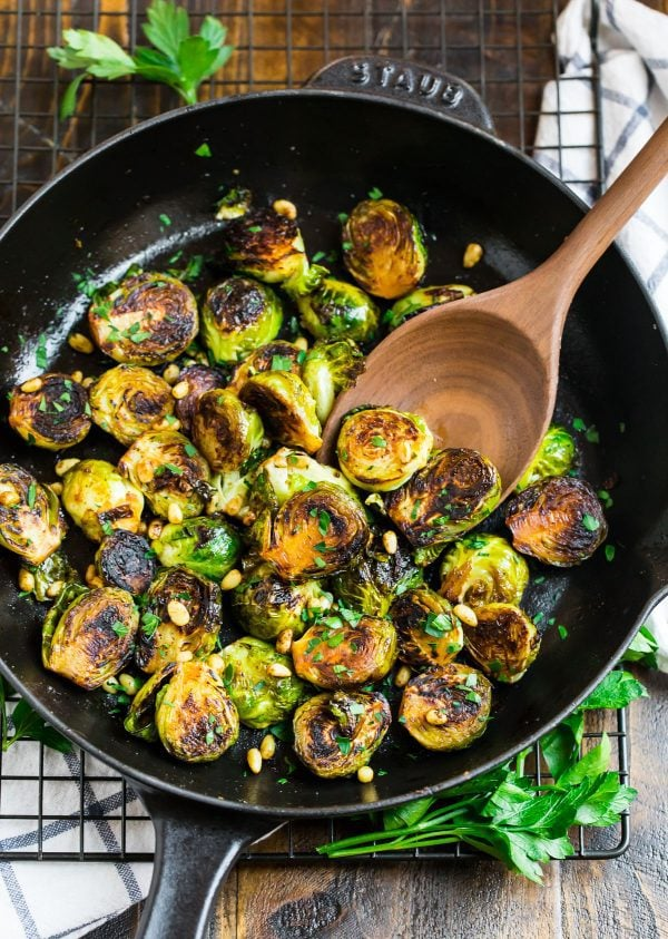 Crispy sautéed Brussels sprouts in a pan with balsamic and pine nuts