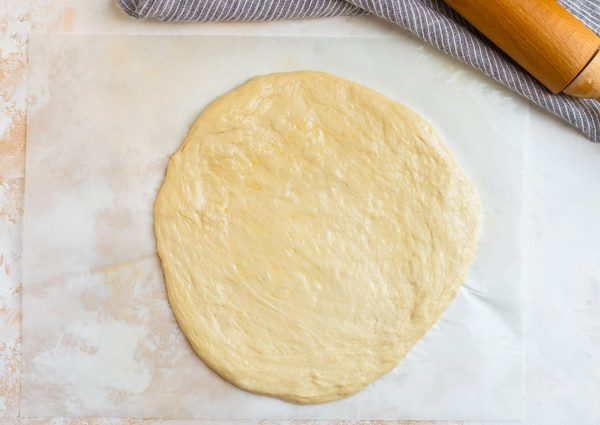 Flattened Pizza Dough Used for Making Delicious Homemade Burrata Pizza