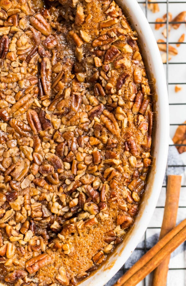 Gooey pecan pie cobbler in a baking dish