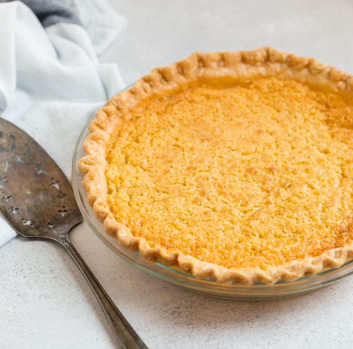 Delicious old fashioned buttermilk pie served in a pie dish