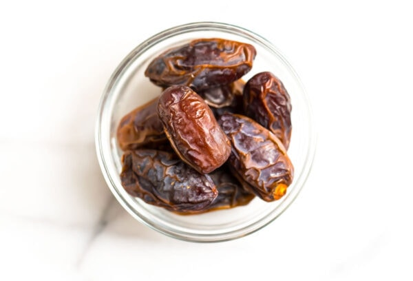 A clear bowl with dates