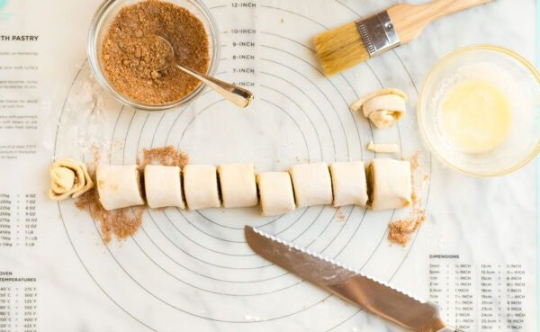 Roll of puff pastry with cinnamon and sugar for making puff pastry cinnamon rolls