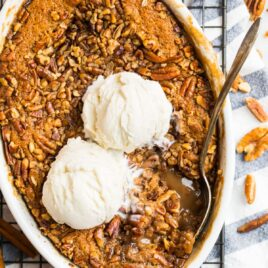 Easy Pecan Pie Cobbler with gooey filling, pecan cobbler topping, and vanilla ice cream