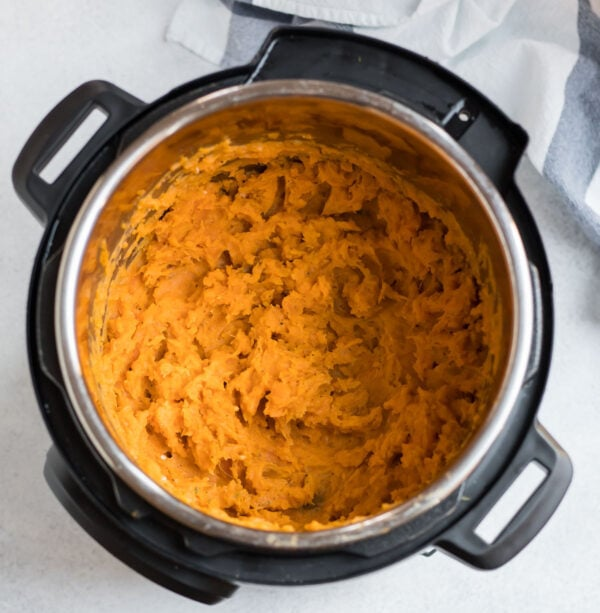 Instant pot garlic mashed sweet potatoes in a pressure cooker