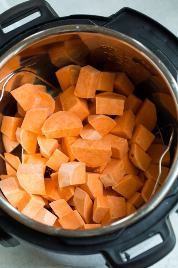 Chopped instant pot sweet potatoes to be mashed for instant pot mashed sweet potatoes