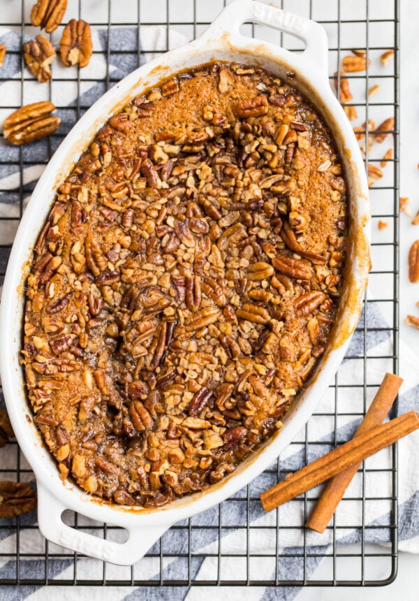Amazing pecan pie cobbler in a baking dish