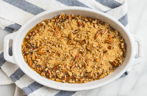 Gooey pecan pie cobbler in a baking dish