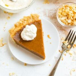 A slice of sweet potato pie on a white plate