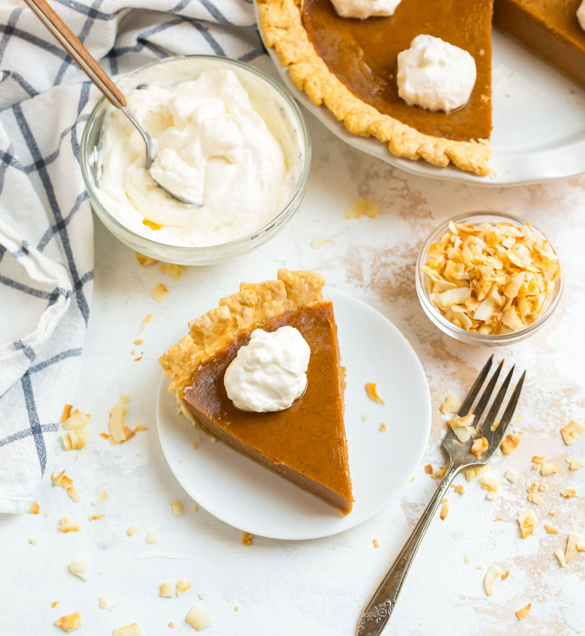 Old fashioned sweet potato pie without nutmeg served with whipped marshmallow cream