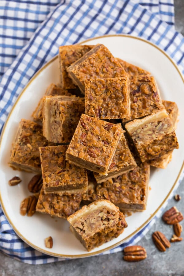 A plate with a stack of delicious bars that taste like pecan pie