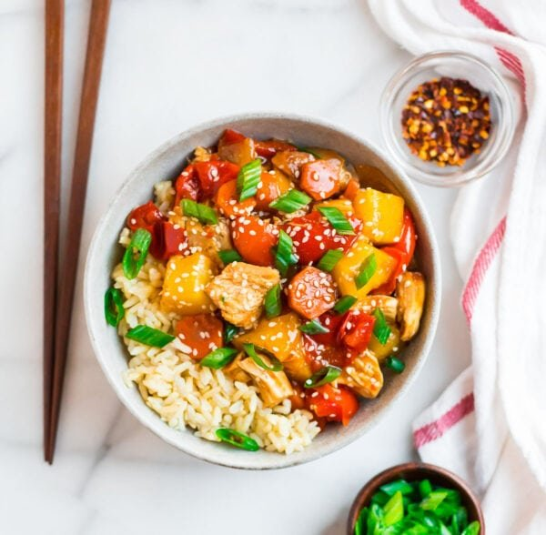Crockpot sweet and sour chicken with pineapple juice served in a bowl